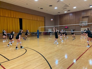 The volleyball team hard at work during practice. - Photograph by Alyssa Holloway